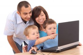family looking at resources on computer