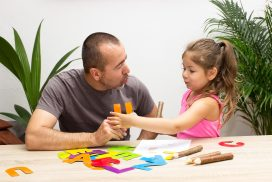 child working with therapist